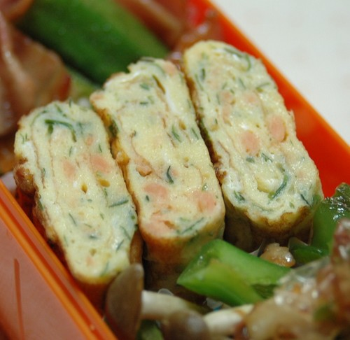 Rolled Omelette with Dried Green Nori Flakes and Salmon Flakes For Lunch Boxes