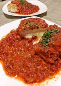 Herb Breaded Chicken Breast Served in Tomato Sauce