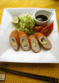 Deep-fried and Breaded Chicken Rolls with Cheese