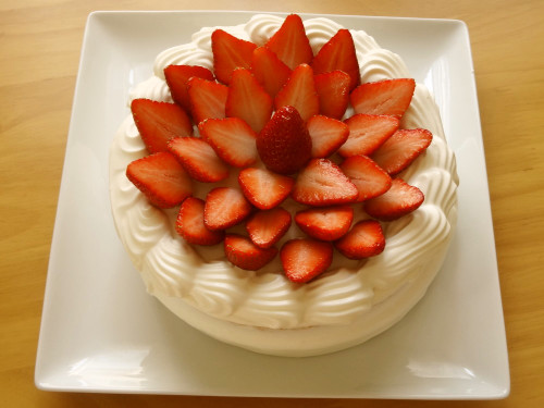 A Patissier's Cake Decorated With Lots of Strawberries