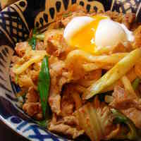 Stir-fried Pork and Kimchi Udon Noodles with Poached Egg