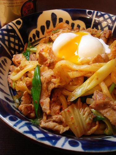 Stir-fried Pork and Kimchi Udon Noodles with Poached Egg