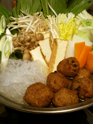 Warming Hot Pot with Deep Fried Meatballs and Chinese Sauce